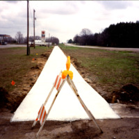 New sidewalk on M1-13 in front of grocery store, ca. 1990